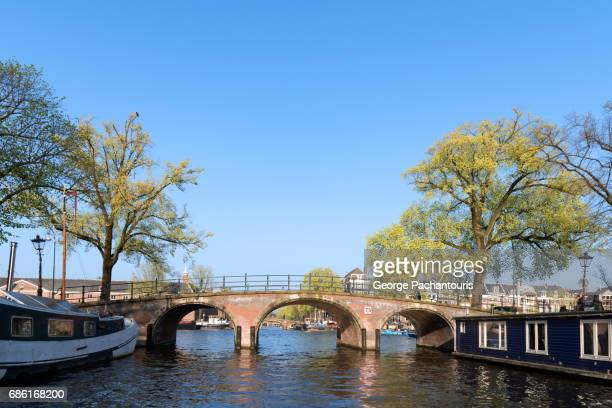 Old bridge and canal houses in Amsterdam, Netherlands