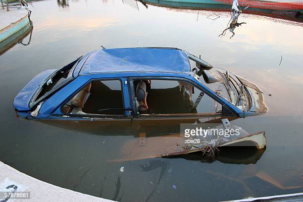 Old broken car submerged in water