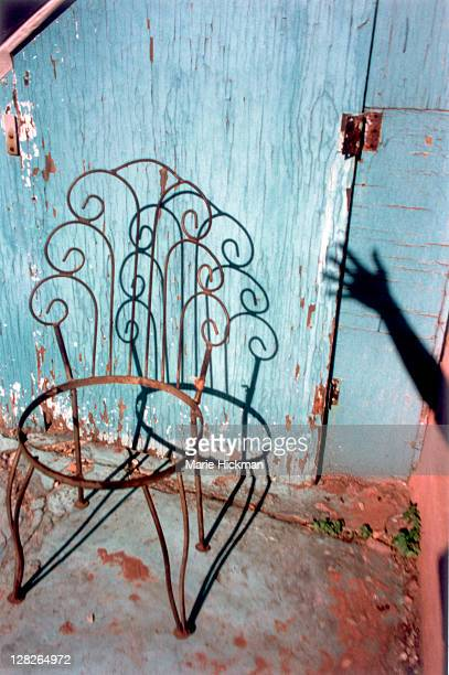 Old broken down iron chair in back yard of an apartment