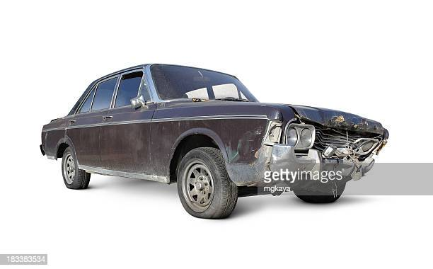 Old brown car with damaged front over a white background