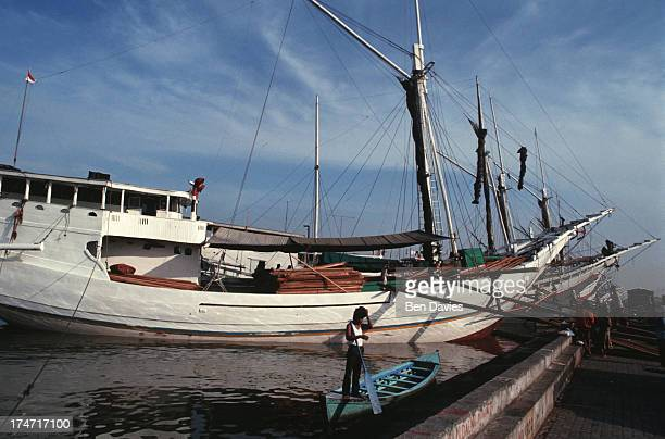Old Buginese Makassar schooners moored at the port of Sunda Kelapa in Jakarta Indonesia This colourful old harbour is situated in the old Dutch part...