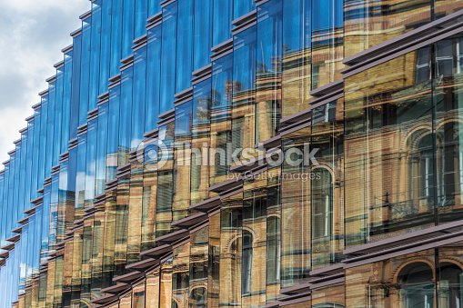 Old building facade reflection in modern building glass for Refection facade