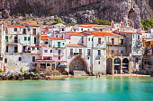 Old building on beach in Cefalu , Sicily, Italy.