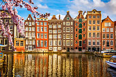 Traditional old buildings in Amsterdam at spring, the Netherlands