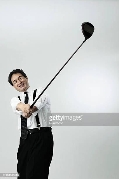 old businessman playing golf