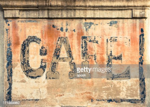 Old cafe sign on a wall in France