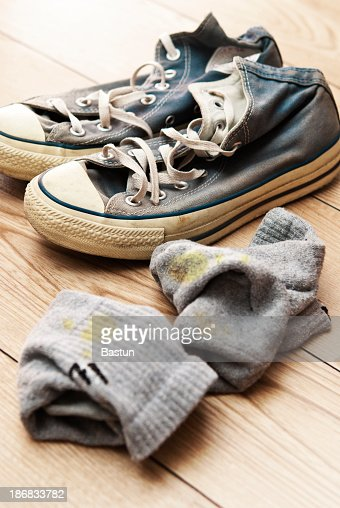 Old canvas lace up shoes with dirty socks