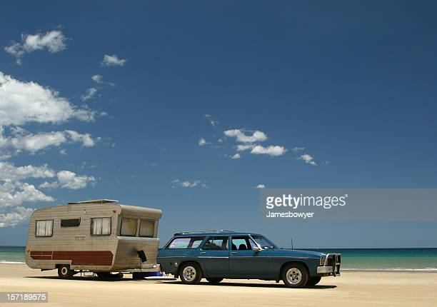 Old caravan & car on beach