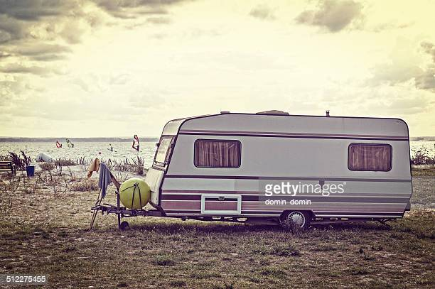 Old Caravan on the bay in retro style 80s