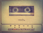 Old cassette player used as background. Retro style.