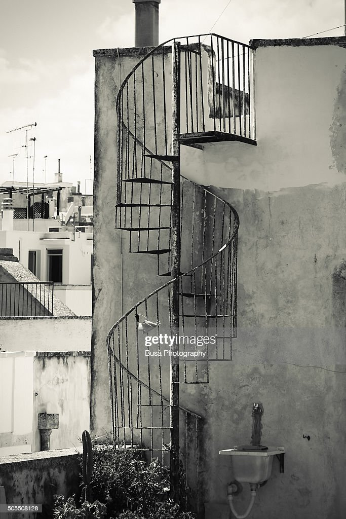Old Cast Iron Spiral Staircase Accessing A Rooftop Terrace In Otranto,  Apulia, Italy :