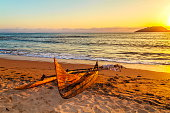 Old Catamaran on the Beach at Nosy Be Island at Sunset,Madagascar.