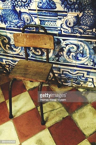 Old Chair Against Tiled Wall