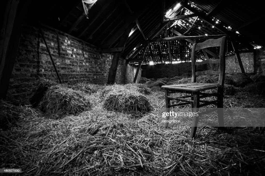Old chair in the attic in black and white : Stock Photo