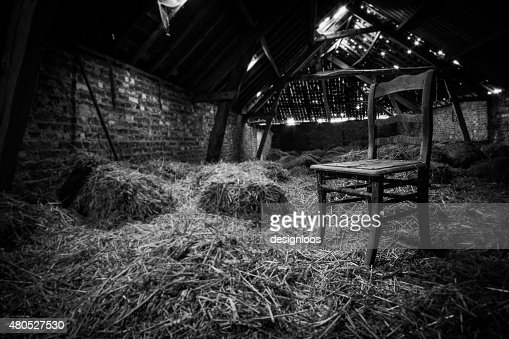 Old chair in the attic in black and white : Bildbanksbilder