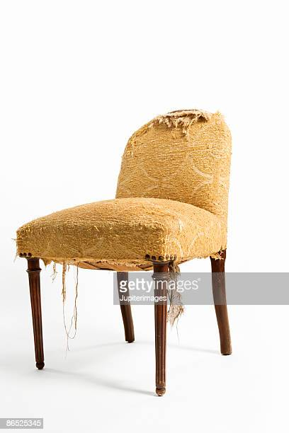 Old chair with torn upholstery