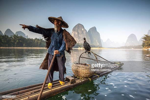 Old chinese fisherman on Li river, Yangshuo China