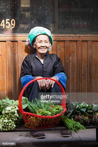 Old chinese Zhuang woman at local market