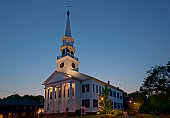 Old church backlit by twilight