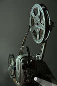 Old cinema projector on a dark background. Retro movie 16 mm