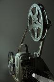 Old cinema projector on a dark background. Retro movie 16 mm