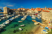 Dubrovnik fortress panorama and harbor with boats and luxury yachts,Dalmatia,Croatia,Europe