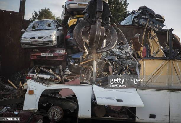 A old coach is broken up by crane at Pylle Motor Spares and Metal Processing a licensed scrap yard in Pylle near Shepton Mallet on March 2 2017 in...