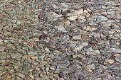 Old cobblestones in a decorative pavement