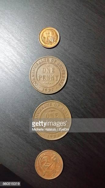 Old Coins Arranged In A Row On Table
