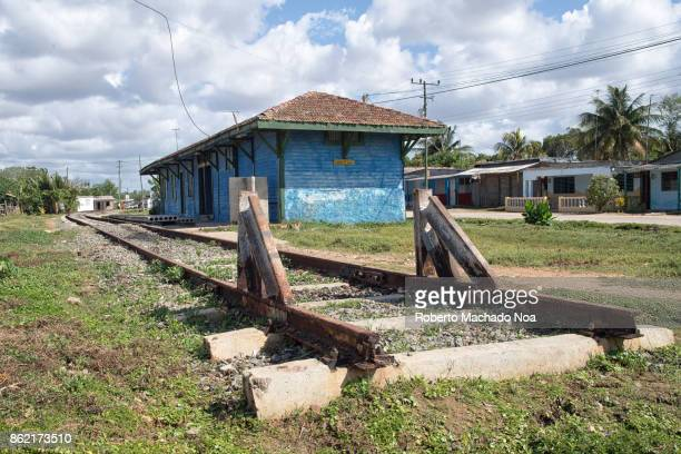 Old colonial wooden train station End of train tracks railway line finish point amid grass field The town had one of the first train connection in...
