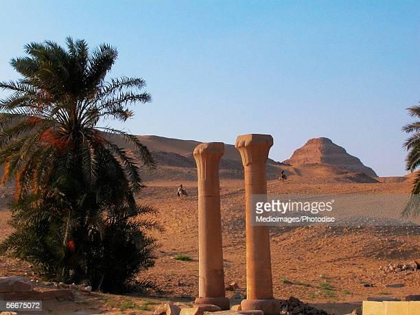 Old columns in an arid landscape, The Step Pyramid Of Zoser, Saqqara, Egypt