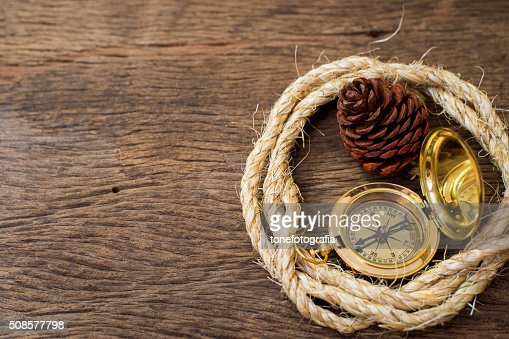 Old Compass and rope on wood background : Stock Photo