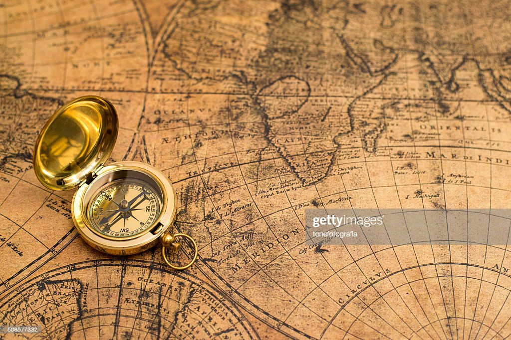 old compass  on vintage map : Stock Photo
