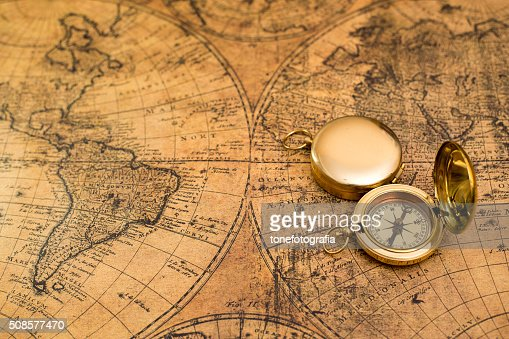 old compass  on vintage map : Bildbanksbilder