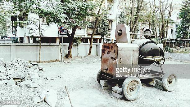 Old Concrete Mixer In Front Of Residential Buildings