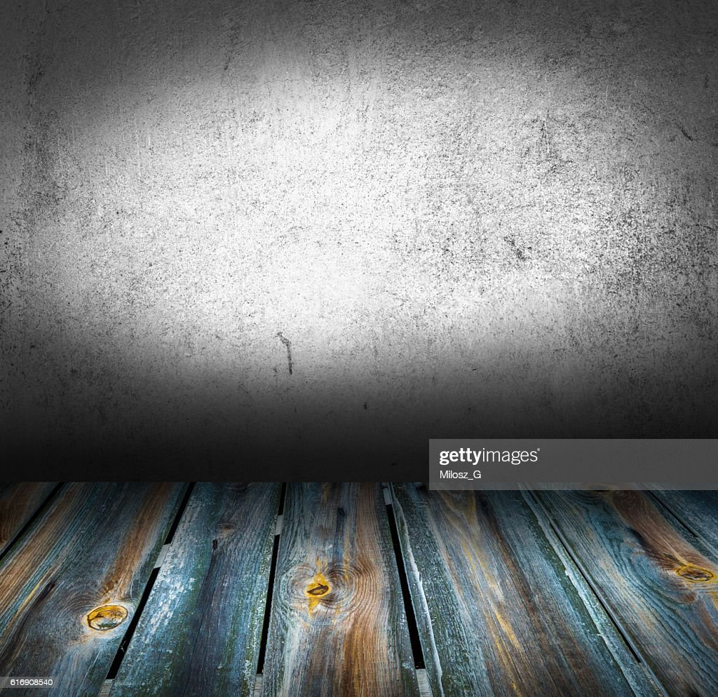 Old concrete wall and wooden floor interior : Stock Photo