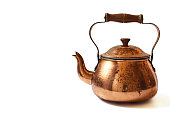 Old copper teapot isolated on white background