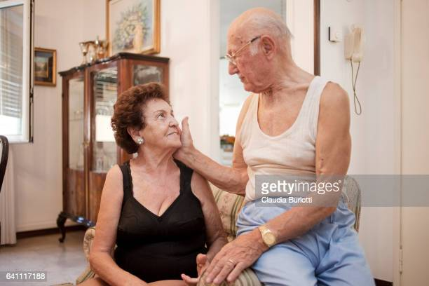 Old couple cuddling