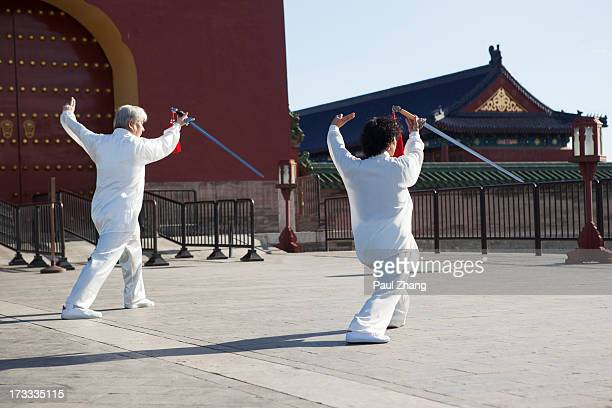Old couple doing Taiji sword in Temple of Heaven