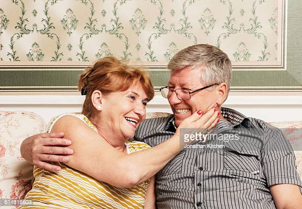 Old couple embracing close up
