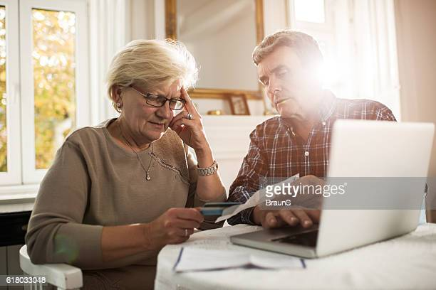 Old couple having problems with their home finances.