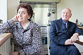 Old couple in the kitchen.