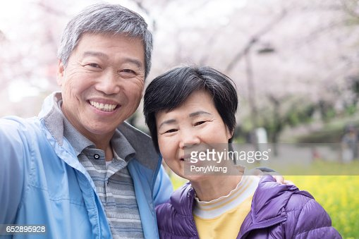 Old couple is smile to you : Stock Photo