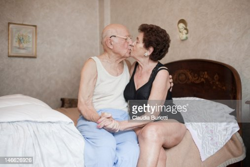 Old couple kissing holding hands