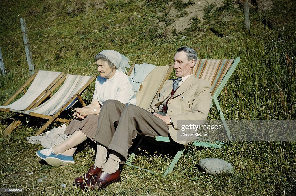 Old couple on resting chairs : Stock Photo