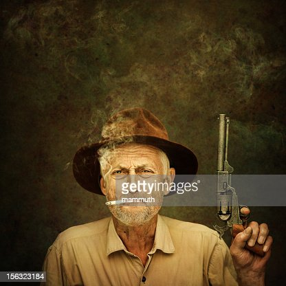 old cowboy with colt : Stock Photo
