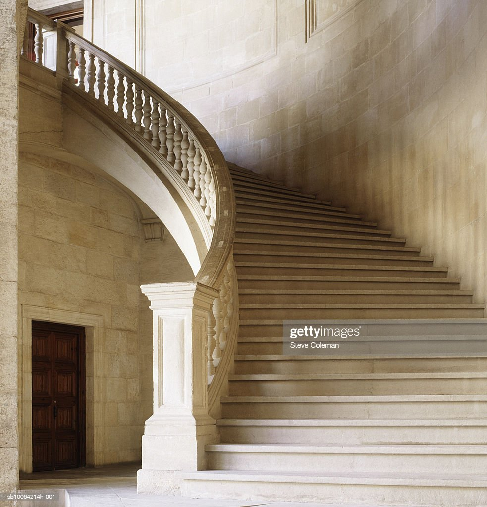 Old curving stone staircase : Stock Photo