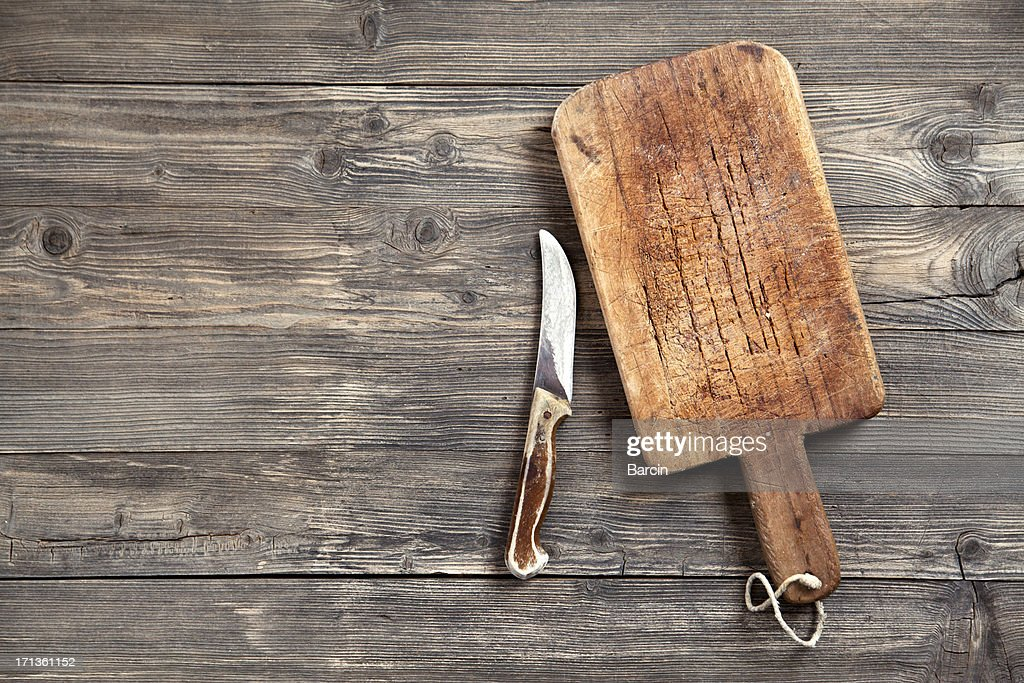 Old cutting board and knife : Stock Photo