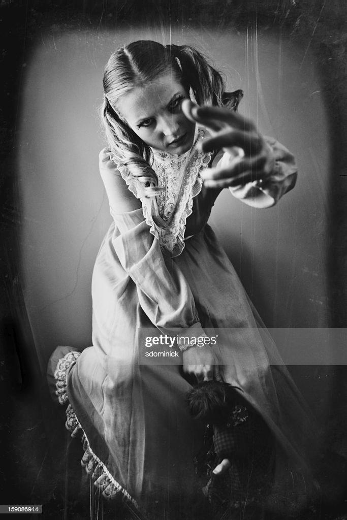 Old Damaged Photo of Creepy Young Girl : Stock Photo