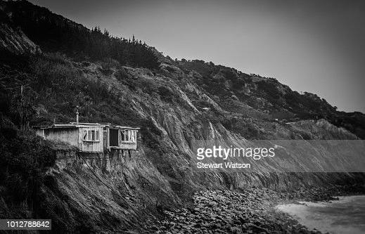 Old derelict house on the edge off the cliff : Stock Photo